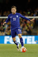 June 7, 2016: KONSTANTINOS STAFYLIDIS (11) of Greece runs with the ball during an international friendly match between the Australian Socceroos and Greece at Etihad Stadium, Melbourne. Photo Sydney Low