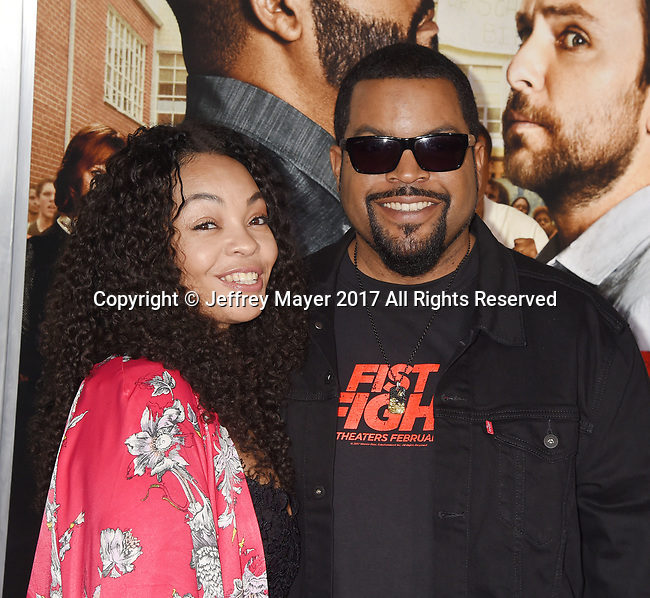 HOLLYWOOD, CA - FEBRUARY 13: Actor-rapper Ice Cube (R) and wife Kimberly Woodruff attend the premiere of Warner Bros. Pictures' 'Fist Fight' at the Regency Village Theatre on February 13, 2017 in Westwood, California.