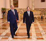 This handout picture released by the Egyptian Presidency on April 14, 2019, shows Egyptian president Abdel Fattah al-Sisi (R) meeting Libyan strongman Khalifa Haftar (L) at the Ittihadia presidential Palace in the capital Cairo.  Egyptian President Abdel Fattah al-Sisi met Sunday with Libyan commander Khalifa Haftar whose forces are fighting for control of the capital Tripoli, state media reported. Sisi has been an ardent supporter of Haftar's forces, which control swathes of eastern Libya and launched an offensive on April 4 to take the capital. Photo by Egyptian President Office