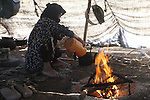 World Water Day. A nomad woman is cooking tea into the Haima in the desert of Sahara