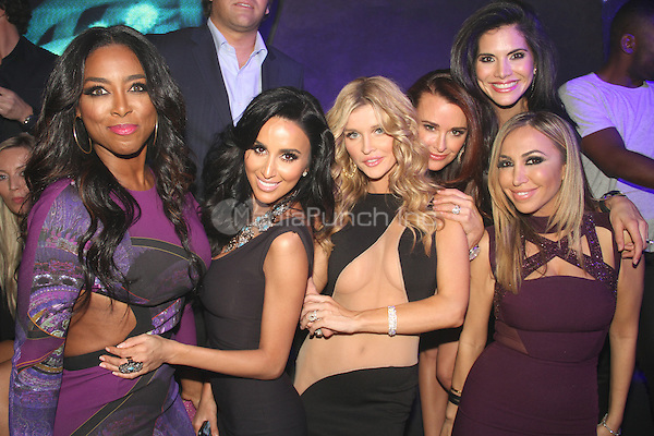 HOLLYWOOD, CA - JANUARY 24: Kenya Moore, guest, Joanna Krupa, Diana Madison attends the OK! Magazine pre-Grammy party at Lure Nightclub on January 24, 2014 in Hollywood, California. Credit: Walik Goshorn/MediaPunch