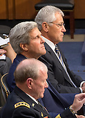 """United States Secretary of Defense Chuck Hagel, U.S. Secretary of State John Kerry, and General Martin Dempsey, Chairman of the Joint Chiefs of Staff testify before the U.S. Senate Foreign Relations Committee on """"Authorization of Use of Force in Syria""""  on Capitol Hill in Washington, D.C. on Tuesday, September 3, 2013.<br /> Credit: Ron Sachs / CNP"""