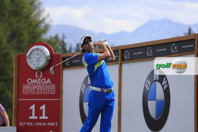 Mark Tullo (CHI) tees off the 11th tee during Saturday's Round 3 of the 2013 Omega European Masters held at Crans Montana Golf Club, Crans-Sur-Sierre Switzerland. 7th September 2013.<br /> Picture: Eoin Clarke www.golffile.ie