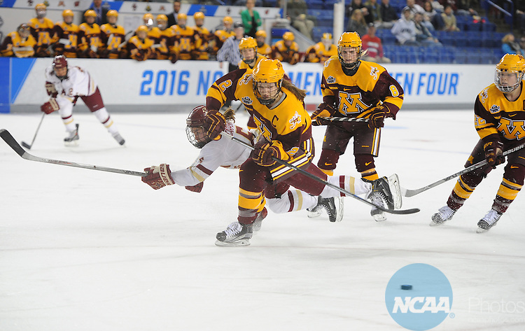 20 MAR 16:  Lee Stecklein of Minnesota blocks out Alex carpenter of Boston College during the Division I Women's Ice Hockey Championship held at Whittemore Center Arena in Durham, NH. Minnesota defeated Boston College 3-1 for the national title.  Gil Talbot/NCAA Photos