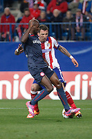 Atletico de Madrid´s Mandzukic (R) and Olympiacos´s Abidal during Champions League soccer match between Atletico de Madrid and Olympiacos at Vicente Calderon stadium in Madrid, Spain. November 26, 2014. (ALTERPHOTOS/Victor Blanco) /NortePhoto