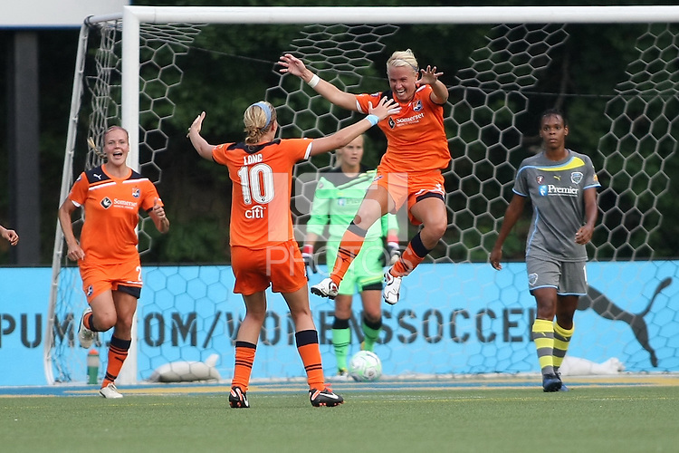 Sky Blue midfielder, Alyssa Mautz (33), leaps into the arms of teammate Aliie Long (10), after scoring her first goal in WPS.  Natasha Kai's hat trick powered Philadelphia to a 4-3 victory over Sky Blue FC on July 6th at Widener University in Chester, PA.