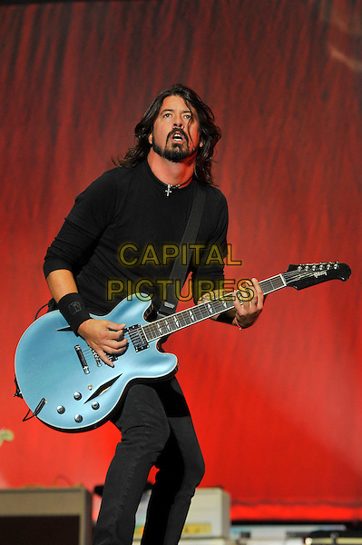 Dave Grohl of 'The Foo Fighters' headlining the main stage on Day 3 at Reading Festival, Reading, England. 26th August 2012.on stage in concert live gig performance performing music half length black top grey gray guitar beard facial hair  3/4 jeans denim.CAP/MAR.© Martin Harris/Capital Pictures.