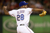 Texas Rangers pitcher Darren Oliver #28 delivers a pitch during the Major League Baseball game against the Texas Rangers at the Rangers Ballpark in Arlington, Texas on July 27, 2011. Minnesota defeated Texas 7-2.  (Andrew Woolley/Four Seam Images)