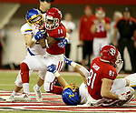 VERMILLION, SD - NOVEMBER 18: Nick Farina #24 from South Dakota State University brings down Michael Fredrick #14 from the University of South Dakota during their game Saturday afternoon at the DakotaDome in Vermillion. (Photo by Dave Eggen/Inertia)