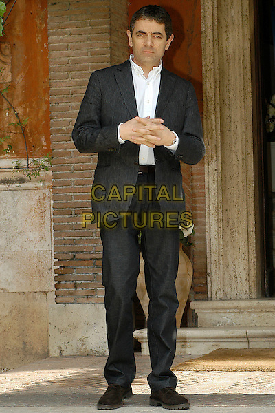 "ROWAN ATKINSON.Photocall for his new film  ""Mr. Bean's Holiday"".Villa del cedro, Rome, Italy, 3rd April 2007..full length grey suit white shirt.CAP/CAV.©Luca Cavallari/Capital Pictures."