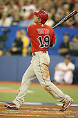 March 7, 2009:  Designated Hitter Joey Votto (19) of Canada hits a home run during the first round of the World Baseball Classic at the Rogers Centre in Toronto, Ontario, Canada.  Team USA defeated Canada 6-5 in both teams opening game of the tournament.  Photo by:  Mike Janes/Four Seam Images