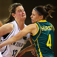 Tall Ferns guard Georgina Richards collides with Natalie Hurst during the International women's basketball match between NZ Tall Ferns and Australian Opals at Te Rauparaha Stadium, Porirua, Wellington, New Zealand on Monday 31 August 2009. Photo: Dave Lintott / lintottphoto.co.nz
