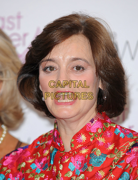 CHERIE BLAIR .Attending Breast Cancer Care's annual Fashion Show hosted by Gail Porter, Grosvenor House Hotel, London, England, UK,.7th October 2009..portrait headshot Booth red pink embroidered floral flower print funny mouth open .CAP/BEL.©Tom Belcher/Capital Pictures.