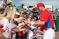 Philadelphia Phillies designated hitter Jim Thome #25 signs autographs before a spring training game against the Houston Astros at Bright House Field on March 7, 2012 in Clearwater, Florida.  (Mike Janes/Four Seam Images)