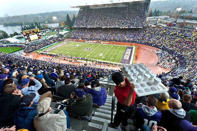 10/30-2010--Seattle, WA, USA..Jake (Jacob) Locker, 22, is the quarterback for the University of Washington Huskies football team. He is the starting quarterback at the on the teak and a top NFL draft prospect when he graduates in 2011. Originally from Ferndale, WASH., Scott Locker, Jake's father and friends and family from Ferndale have been regular tailgaters at all his games in a group called the 'Ferndawgs'...Here, the UW Huskies fans enjoy the game in the upper decks in the aging stadium the school has wanted to replace for years. The University of Washington has tried, unsuccessfully, to persuade Washington State lawmakers in Olympia to contribute $150 million in public money to go toward a $300 million stadium remodel. ..©2010 Stuart Isett. All rights reserved.