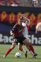 The MetroStars' Craig Ziadie looks to keep the ball away from D.C. United's Bobby Convey. D. C. United was defeated by the NY/NJ MetroStars 3 to 2 during the MetroStars home opener at Giant's Stadium, East Rutherford, NJ, on April 17, 2004.