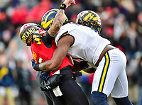 College Park, MD - NOV 11, 2017: Maryland Terrapins quarterback Ryan Brand (16) is hit hard by Michigan Wolverines defensive lineman Rashan Gary (3) during game between Maryland and Michigan at Capital One Field at Maryland Stadium in College Park, MD. (Photo by Phil Peters/Media Images International)