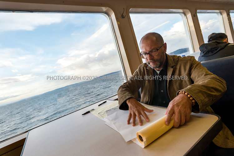 10/21/2014&mdash;Bainbridge to Seattle Ferry, Puget Sound, WA, USA<br /> <br /> Alan Maskin, a partner at Seattle'&rsquo;s Olson Kundig Architects, working on the Bainbridge to Seattle ferry during his morning commute.<br /> <br /> CREDIT: Stuart Isett for the Wall Street Journal<br /> <br /> FIXSPACE_Ferry<br /> <br /> <br /> &copy;2014 Stuart Isett. All rights reserved.