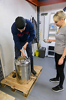 Tom Wilson and Lucy Holmes, founders of KANPAI London Craft Sake. Tom is stirring a container of sake starter. London, UK, October 3, 2017. KANPAI London Sake was founded in February 2017 by wife and husband team Lucy Holmes and Tom Wilson in Peckham, South London. It is the UK's first sake brewery and produces artisan small-batch sake.