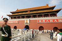 Tian'anmen Square (Place of Heavenly Peace). Tian'anmen Gate. Mao portrait and policeman not wanting his picture taken.