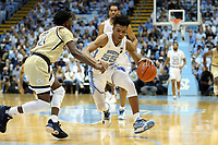 CHAPEL HILL, NC - JANUARY 4: Christian Keeling #55 of the University of North Carolina drives the lane against Bubba Parham #11 of Georgia Tech during a game between Georgia Tech and North Carolina at Dean E. Smith Center on January 4, 2020 in Chapel Hill, North Carolina.