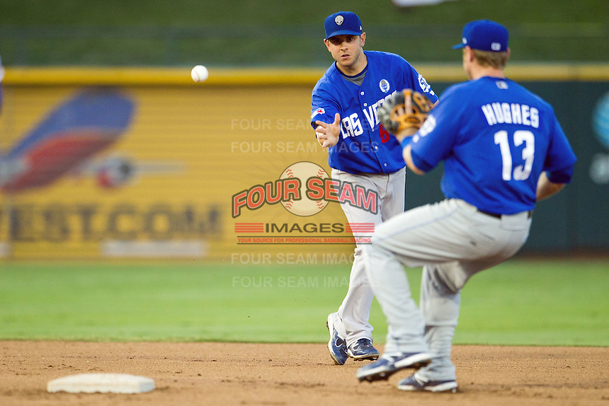 Las Vegas 51s shortstop Jonathan Diaz #6 flips the ball to second baseman Luke Hughes #13 during a double play attempt at the Pacific Coast League baseball game against the Round Rock Express on August 7th, 2012 at the Dell Diamond in Round Rock, Texas. The Express defeated the 51s 5-4. (Andrew Woolley/Four Seam Images).