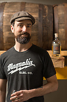 Chris June of Fair Game Beverage Company, a distillery that makes a Sorghum Cane Spirit, or Sorghum Rhum in Pittsboro, N.C. on Friday, March 20, 2015. (Justin Cook)