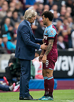 West Ham Utd Manager Manuel Pellegrini with substituted Felipe Anderson of West Ham Utd during the Premier League match between West Ham United and Manchester United at the Olympic Park, London, England on 22 September 2019. Photo by Andy Rowland / PRiME Media Images.