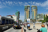 Tanzania Dar es Salaam, left ferry station to Zanzibar and construction of new skyscrapers / TANSANIA Dar es Salam, Faehrstation und Neubau neuer Hochhaeuser