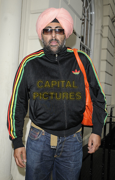 HARDEEP SINGH KOHLI.Arrives for the Annual Omar Sharif Backgammon Tournament, Sketch bar & restaurant, London, England, UK, .May 16th 2010..half length pink turban adidas black top jeans sunglasses red green yellow  stripes striped bag orange .CAP/CAN.©Can Nguyen/Capital Pictures.