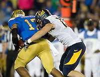Kyle Kragen of California tackles UCLA quarterback Brett Hundley during the game at Rose Bowl in Pasadena, California on October 12th, 2013.   UCLA defeated California, 37-10.