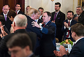 United States President Donald J. Trump hugs Governor Gary Herbert (Republican of Utah) after speaking to a group of governors during the 2019 White House Business Session at the White House in Washington, D.C. on February 25, 2019. Trump discusses the group on infrastructure, the opioid epidemic, border security and China trade policy. <br /> Credit: Kevin Dietsch / Pool via CNP