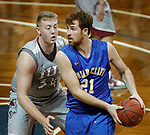 SIOUX FALLS, SD - MARCH 9:  Blake Wiltgen #21 of Briar Cliff shields the ball from Nate Niehoff #34 of IU east at the 2018 NAIA DII Men's Basketball Championship at the Sanford Pentagon in Sioux Falls. (Photo by Dick Carlson/Inertia)