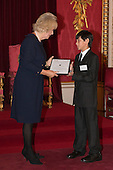 London, Uk. 15/10/2015. HRH The Duchess of Cornwall with Nathan Swain, 11, Junior Winner from St Mary's School, Tristan da Cunha. The Duchess of Cornwall on behalf of Her Majesty The Queen, Patron of The Royal Commonwealth Society, holds a reception for winners of The Queen's Commonwealth Essay Competition at Buckingham Palace. The Queen's Commonwealth Essay Competition was founded in 1883 and is the world's oldest international schools' writing contest. This year's competition, sponsored by Cambridge University Press, received more than 13,000 entries from over 600 schools in 49 Commonwealth countries and territories. The Duchess of Cornwall hands out awards to young writers who have travelled from across the Commonwealth to attend the reception. This year's winners have come from Cyprus, Botswana, The Cayman Islands and as far away as Tristan da Cunha - over 9000km away.