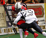 SIOUX FALLS, SD - MARCH 17:  Eric McCain #8 from the Sioux Falls Storm is hit by Abraham Woodard #25 from the Wyoming Calvary in the first quarter of their game Sunday afternoon at the Sioux Falls Arena. (Photo by Dave Eggen/Inertia)