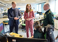 19/03/2020 - Picture released by Kensington Palace of Prince William Duke of Cambridge and Kate Duchess of Cambridge accompanied by the Chief Executive of the London Ambulance Service, Garrett Emmerson (right) talking with staff during a visit to the London Ambulance Service 111 control room in Croydon on Thursday to meet ambulance staff and 111 call handlers who have been taking NHS 111 calls from the public, and thank them for the vital work they are doing. Photo Credit: ALPR/AdMedia