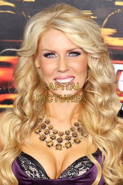 "GRETCHEN ROSSI.Twentieth Century Fox world premiere of Tony Scott's action-thriller, ""Unstoppable,"" at the Regency Village Theater in Westwood. Los Angeles, CA, USA, October 26th, 2010. .portrait headshot necklace smiling  purple bra lace black  cleavage .CAP/CEL.©CelPh/Capital Pictures."