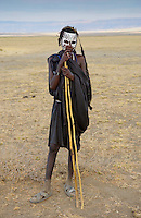 Young recently circumcised Masai Warrior (moran) with traditional face paint after 'coming of age'  in the Serengei Plains, Tanzania