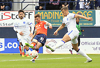 Jordan Cook of Luton Town curls in an effort on goal during the Sky Bet League 2 match between Luton Town and Mansfield Town at Kenilworth Road, Luton, England on 22 October 2016. Photo by Liam Smith.