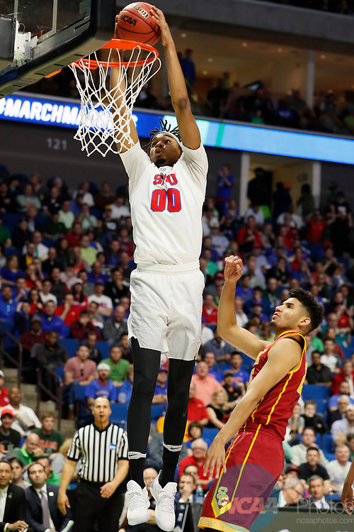 TULSA, OK - MARCH 17:  Ben Moore (0) of the Southern Methodist Mustangs dunks during the 2017 NCAA Men's Basketball Tournament held at the BOK Center on March 17, 2017 in Tulsa, Oklahoma. (Photo by David Klutho/NCAA Photos via Getty Images)