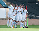 Morton's Tomas Peciar (4) celebrates after he scores their first goal.
