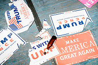Discarded campaign signs lay on the floor after President-elect Donald Trump spoke in the ballroom in the Midtown Hilton at the election night victory rally for Republican presidential nominee Donald Trump, after the presidential race was called for Trump in the early hours of Nov. 9, 2016.