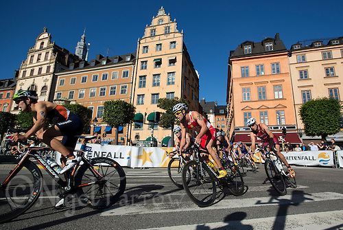 25 AUG 2013 - STOCKHOLM, SWE - Competitors round a bend during the elite men's ITU 2013 World Triathlon Series round in Gamla Stan in Stockholm, Sweden (PHOTO COPYRIGHT © 2013 NIGEL FARROW, ALL RIGHTS RESERVED)