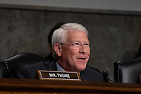Senator Roger Wicker, Republican of Mississippi,, listens to testimony from a witness during a Senate Commerce Committee hearing on Capitol Hill in Washington, DC on February 6, 2019. Credit: Alex Edelman / CNP