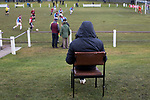 Whitehill Welfare 3 Gala Fairydean Rovers 0, 12/03/2016. Ferguson Park, Rosewell, Scottish Lowland League. A spectator sitting in a chair watching the action at Ferguson Park, Rosewell, as Whitehill Welfare take on Gala Fairydean Rovers in a Scottish Lowland League fixture, which the home team won 3-0. The match was one of six arranged by the league and GroundhopUK over the weekend to accommodate groundhoppers, fans who attempt to visit as many football venues as possible. Around 100 fans in two coaches from England participated in the 2016 Lowland League Groundhop and they were joined by other individuals from across the UK which helped boost crowds at the six featured matches. Photo by Colin McPherson.