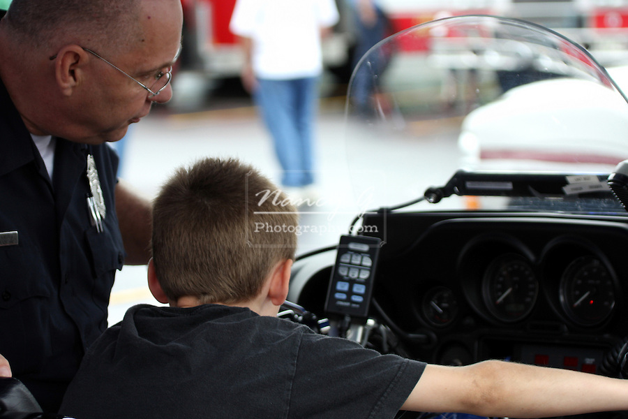 A young boy on a Police motorcycle at the Menomonee Falls Fire and Police Department Safety Fair