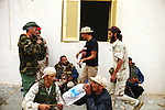 Sirte, LIBYA: Monday 11th October 2011:..Rebel fighters take a break during the battle for the Libyan city of Sirte. Once rebels capture Sirte,  Gaddafi's hometown, the National Transitional Council (NTC) say they will declare national liberation, even if Col Gaddafi remains at large...Ayman Oghanna