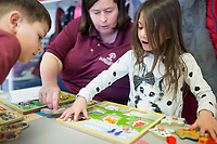 NWA Democrat-Gazette/CHARLIE KAIJO Pre-K teacher Laura Thompson (center) works on a puzzle with Knox Hensley-Nichols, 5, (from left) and Audrina Williamson, 5, Monday, February 12, 2018 at Helen R. Walton Children&acirc;&euro;&trade;s Enrichment Center in Bentonville. <br />