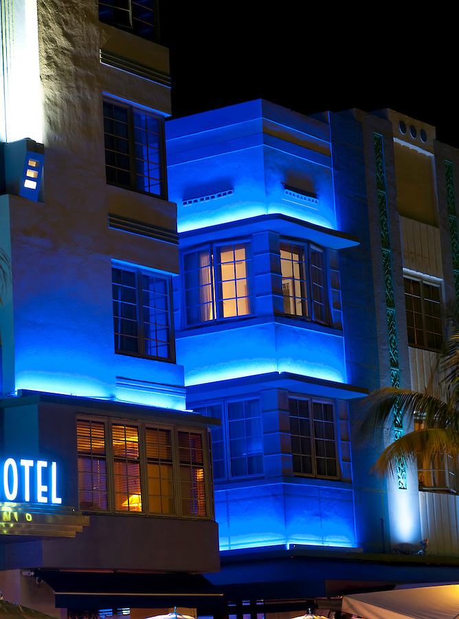"""Historical motels in South Beach famous """"Ocean Drive"""" at night."""