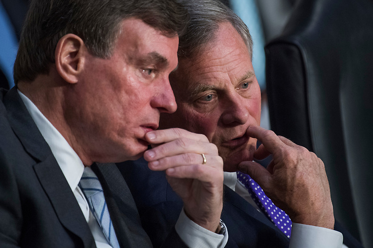 "UNITED STATES - MAY 11: Chairman Richard Burr, R-N.C., right, and Ranking Member Mark Warner, D-Va., conduct  a Senate (Select) Intelligence Committee hearing in Hart Building titled ""World Wide Threats"" on May 11, 2017. (Photo By Tom Williams/CQ Roll Call)"